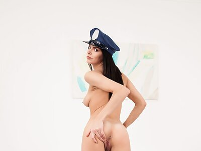Black-haired girl in a cop uniform fingering her puffy pussy
