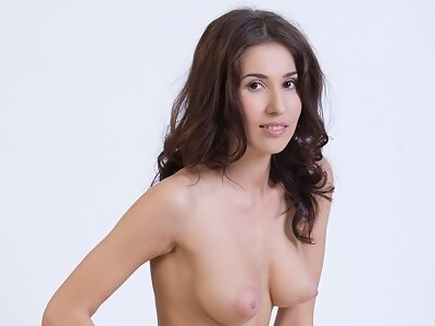 Brunette with torpedo tits posing naked