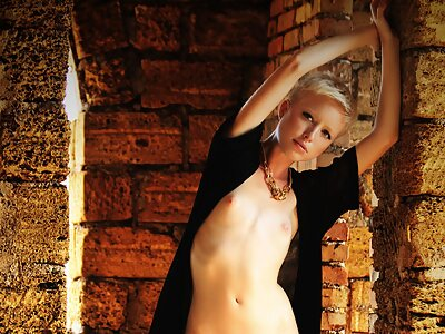 Short-haired blonde with tiny titties posing nude