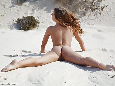 Teen with puffy nipples nude in the sand