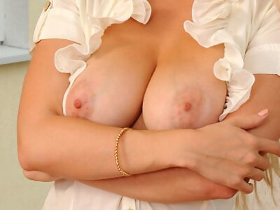 Blonde shows off her big veiny tits