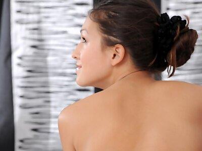 Stunning busty brunette posing naked