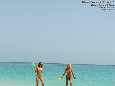 Tanned lesbains in bikini having fun at the beach