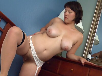 Busty hairy brunette rubs her big clit