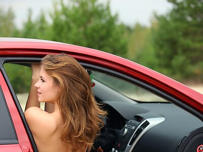 Shaved girl nude in a car