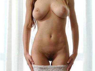 Hairy busty brunette posing nude