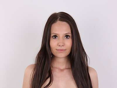 Casting pics of a shaved brunette with pale skin