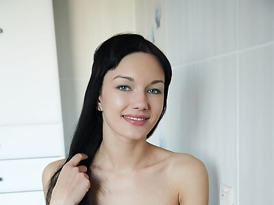 Black-haired girl shows off her meaty pussy