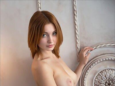Busty redhead hottie posing nude