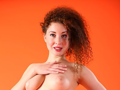 Shaved redhead with big pussy lips posing spreading