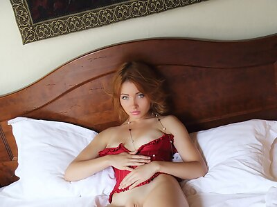 Gorgeous busty redhead in lingerie
