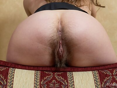 Flat-chested brunette spreads her hairy pussy