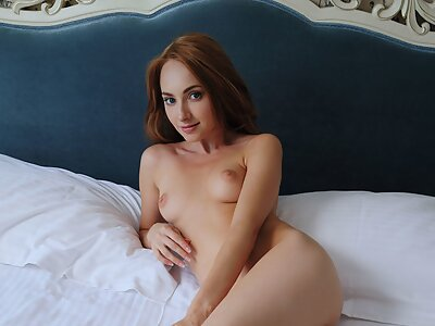 Shaved redhead shows off her meaty pussy lips