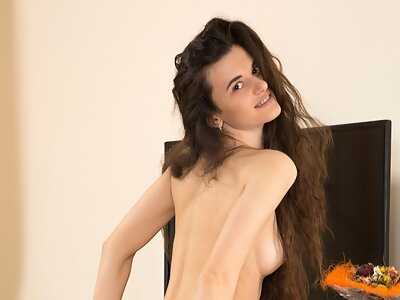 Long-haired brunette in stockings spreading her meaty pussy lips