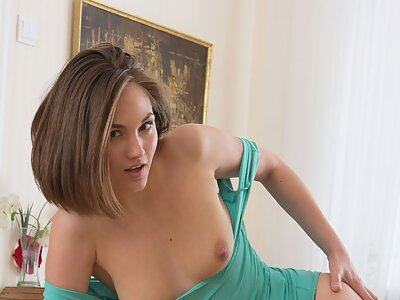 Sexy brunette fingering her shaved pussy