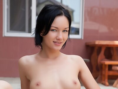 Black-haired hottie shows off her puffy pussy