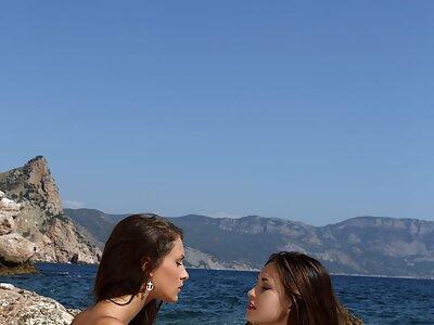 Sexy lesbians masturbating by the sea