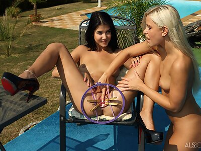 Shaved black-haired lesbian Lady Dee toying outdoors