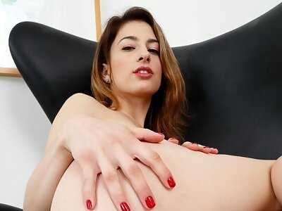 Brunette Kristen Scott plays with her huge pussy lips
