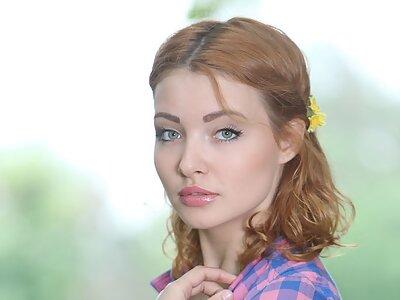 Busty redhead hottie Kika nude in a forest