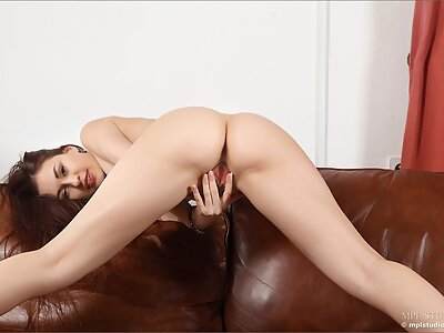 Sexy brunette Demi Fray spreads her pussy on a couch