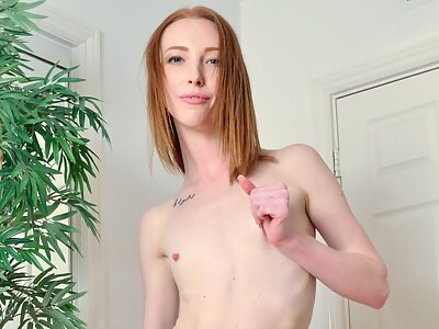 Freckled redhead gapes her asshole