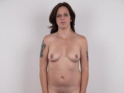 Brunette amateur spreads her meaty pussy lips