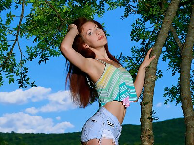 Redhead girl with big pussy lips nude in a field