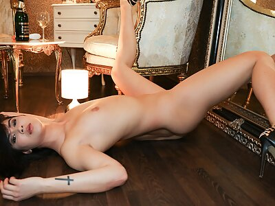 Black-haired babe Lady Dee stripping and toying