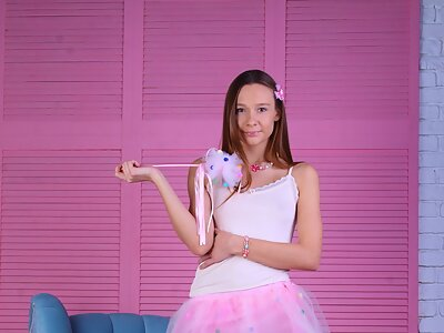 Shaved girl in a pink tutu