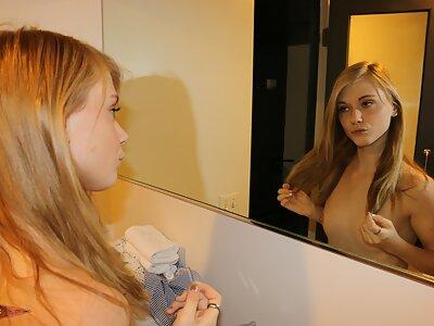 Cute blonde teen spreads big pussy lips