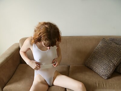 Cute redhead amateur plays with her hairy pussy