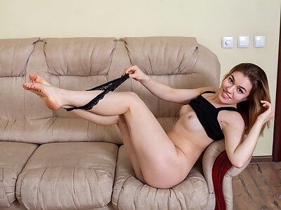 Shaved blonde spreads her big pussy lips on the couch
