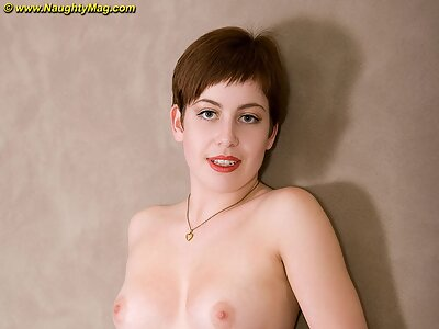 Short-haired redhead spreads her big pussy lips