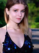 Pale teen lifts up her skirt outdoors