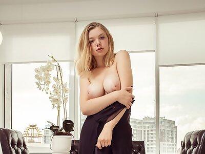 Cute blonde Daniel Sea shows off her big tits