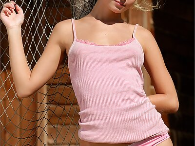Blonde with huge puffy nipples posing