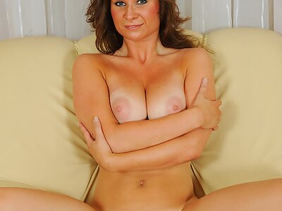 Busty brunette with tan lines toying