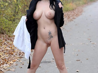 Brunette with big natural tits flashing