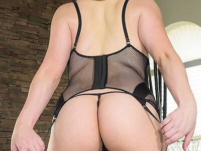Chubby busty blonde in black lingerie