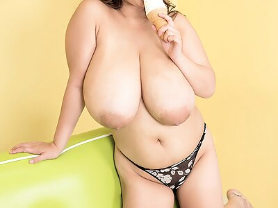 Chubby Asian girl shows off her huge boobs