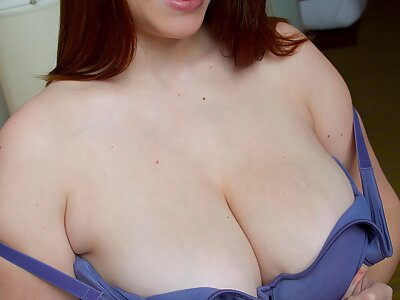 Chubby brunette shows off her enormous tits and areolas