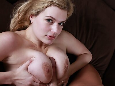 Horny busty blonde fucked on the couch