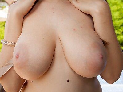 Busty brunette sucking a cock