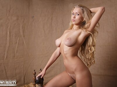 Long-haired busty blonde posing nude