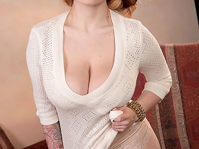 Busty redhead babe shows off her huge areolae