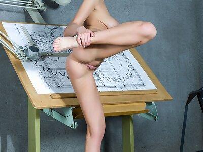 Busty black-haired hottie spreads her legs