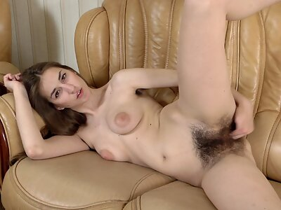 Long-haired amateur with big areolas fingers her hairy pussy