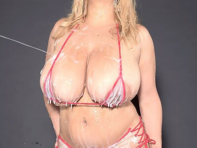 Latina with huge boobs sprayed with cream
