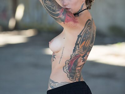 Tattooed girl with large areolas posing nude